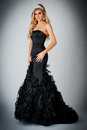 Woman in Black Ball Gown Dress. Stock Images