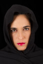 Woman in black cape with sad face and red lips portrait Stock Images