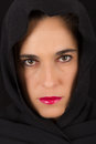 Woman in black cape with sad face and red lips portrait Stock Photography