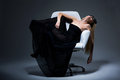 Woman black dress resting armchair satisfaction Royalty Free Stock Photography