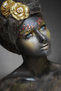 Woman with black face art photo of a beautiful art art fantasy make up Stock Photography