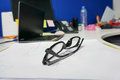 Woman black glasses on the office desk