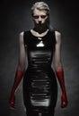 Woman in black latex dress Royalty Free Stock Photo