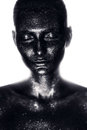 Woman in black paint in white light studio Royalty Free Stock Photos