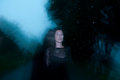Woman in Black Shrouded in Darkness and Mystery Royalty Free Stock Photo