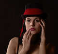 Woman in black tophat with red shawl Royalty Free Stock Photo