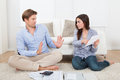 Woman Blaming Man For Excessive Expenses At Home Royalty Free Stock Photo