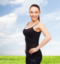 Woman in blank black shirt design concept smiling Royalty Free Stock Images