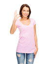 Woman in blank pink t-shirt showing ok gesture Royalty Free Stock Photo