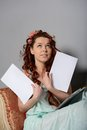 Woman with a blank sheet looks up Stock Photo