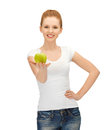 Woman in blank t-shirt eating green apple Royalty Free Stock Image