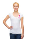 Woman in blank t shirt with pink cancer ribbon healthcare medicine and breast concept Stock Photography