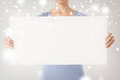 Woman with blank white board shopping sale advertisement christmas x mas concept hands showing Stock Photography