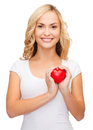 Woman in blank white shirt with small red heart design health charity love concept smiling Royalty Free Stock Images