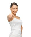 Woman in blank white t shirt pointing her finger happy Royalty Free Stock Photo