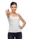 Woman in blank white t shirt pointing her finger happy Stock Photos