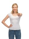 Woman in blank white t shirt pointing her finger happy Royalty Free Stock Photos