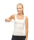 Woman in blank white t shirt pointing at herself happy Stock Photo