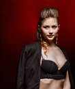 Woman blonde in black bra and man jacket sexuality young beautiful fashion hairstyle sexy lingerie s on red background elegance Stock Photo
