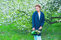 Woman in blooming spring garden Royalty Free Stock Photo