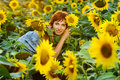 Woman on blooming sunflower field Royalty Free Stock Photography
