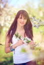 Woman in blooming trees in spring Royalty Free Stock Photo