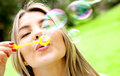 Woman blowing bubbles Royalty Free Stock Photography