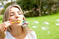 Woman blowing bubbles Royalty Free Stock Photo