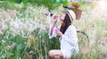 Woman blowing bubbles in meadow Royalty Free Stock Photo