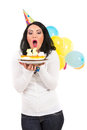 Woman blowing cake candles birthday isolated on white background Royalty Free Stock Photos
