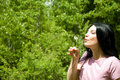 Woman blowing dandelion Royalty Free Stock Photo