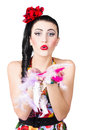Woman blowing feathers attractive young beautiful Royalty Free Stock Images
