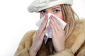 Woman blowing her nose Royalty Free Stock Images