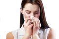Woman blowing her nose sick young isolated on white background Royalty Free Stock Image