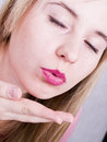 Woman blowing a kiss Stock Photography
