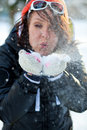 Woman blowing snow Royalty Free Stock Image