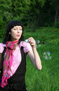 Woman blowing soap bubbles Stock Images