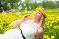 Woman blowing soap bubbles Royalty Free Stock Photo