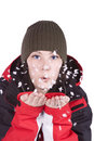 Woman blowing soft white flakes Royalty Free Stock Photography