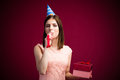 Woman blowing in whistle and holding gift Royalty Free Stock Photo