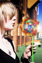 Woman Blowing Windmill Toy Stock Images
