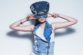 Woman in blue denim hat and waistcoat Royalty Free Stock Photo