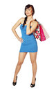 Woman in blue dress happy and a lot of shopping bags Stock Photo