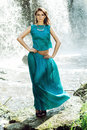 Woman in a blue dress near a waterfall Royalty Free Stock Photo