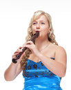 Woman in Blue Dress Playing Flute Royalty Free Stock Photo