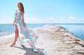 Woman in a blue dress on the sea coast Royalty Free Stock Photo