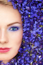 Woman in blue flowers Royalty Free Stock Image