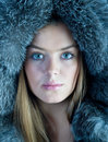 Woman in blue fur hat Stock Image