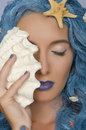 Woman with blue hair, shells and closed eyes Royalty Free Stock Photo