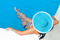 Woman in blue hat at the pool Stock Image